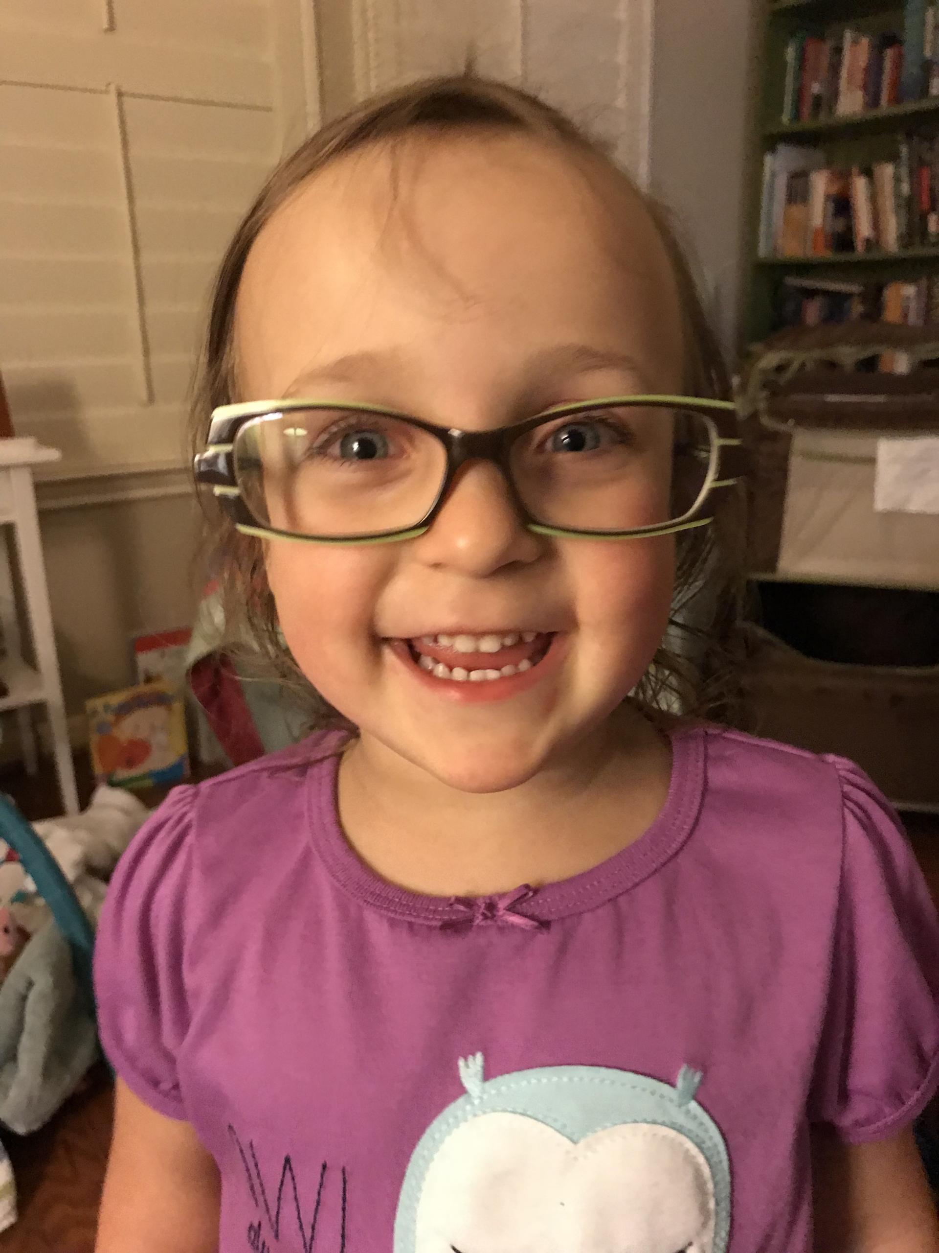 Ellie wearing Gika's glasses